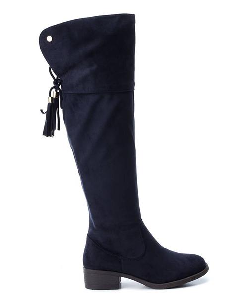 mujeres con botas altas