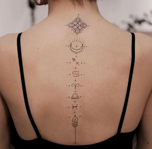 tatuaje espalda mujer columna